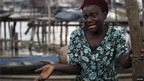 A woman reacts to authorities pulling down shelters and dwellings on the Makoko settlement in Lagos, Nigeria