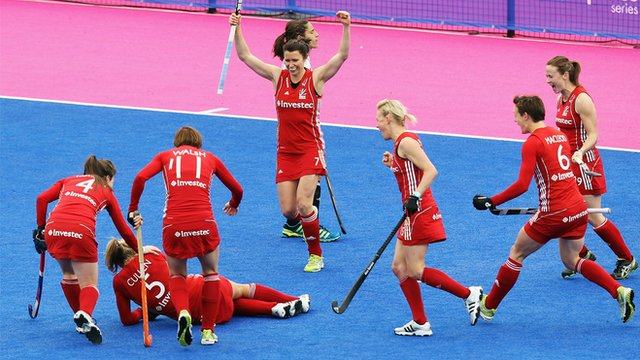 GB women's hockey team celebrate