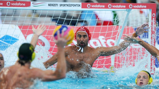 Hungarian and Australian water polo players in action
