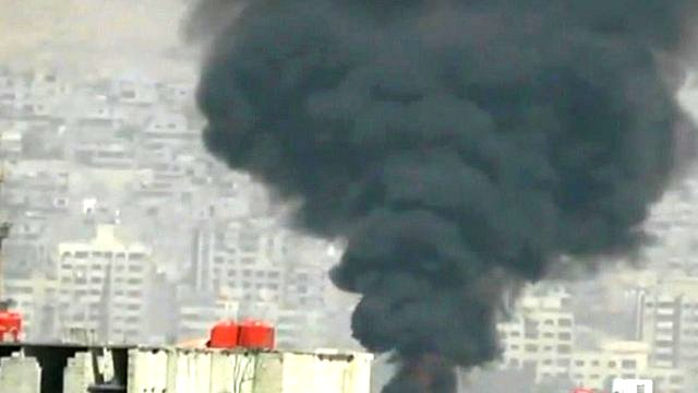 Still from unverified footage purports to show smoke rising from Damascus skyline