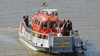 Promising sailor Aaron Reynolds, 18, carried the flame across the Thames in a London Fire Brigade boat, accompanied by a flotilla of small craft.