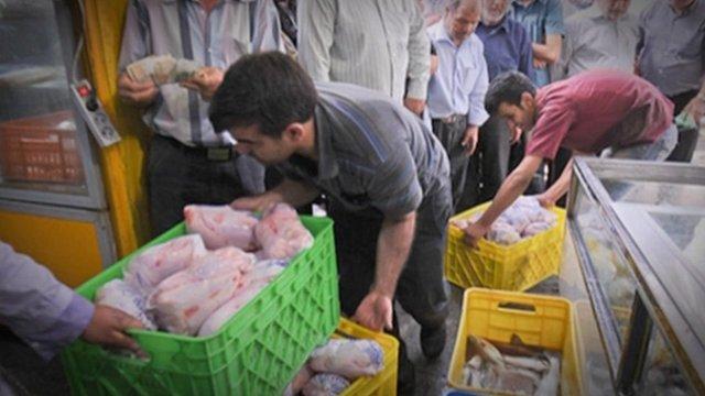 Chicken farmers in a bazaar in Tehran