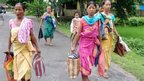 Bodo tribal people flee their homes in Kokrajhar district, about 230 kms from Guwahati, the capital city of the northeastern state of Assam during violent clashes on July 23, 2012.