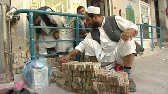 An Afghan money trader in Kabul