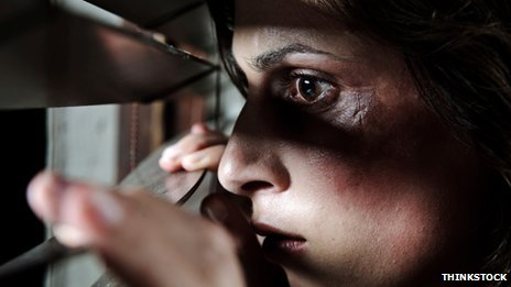 A generic picture of a domestic violence victim looking out of the window