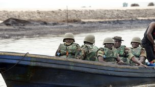 Soldiers in a boat in the Niger Delta (archive shot)