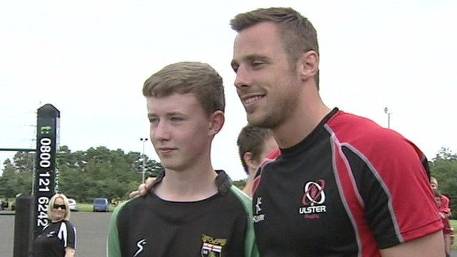 Tommy Bowe meets a fan at the City of Derry Rugby club