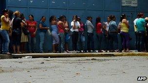 Women wait in line in Venezuela