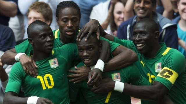 Senegal's Moussa Konate is congratulated by his teammates