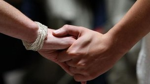 A couple handing hands