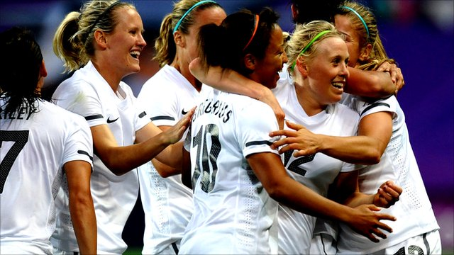New Zealand players celebrate their second goal.
