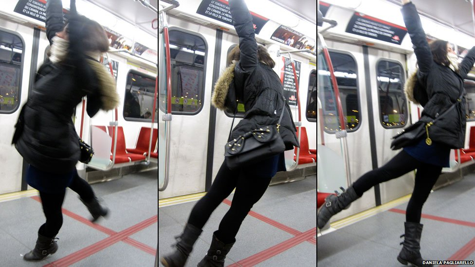 Swinging on an underground train