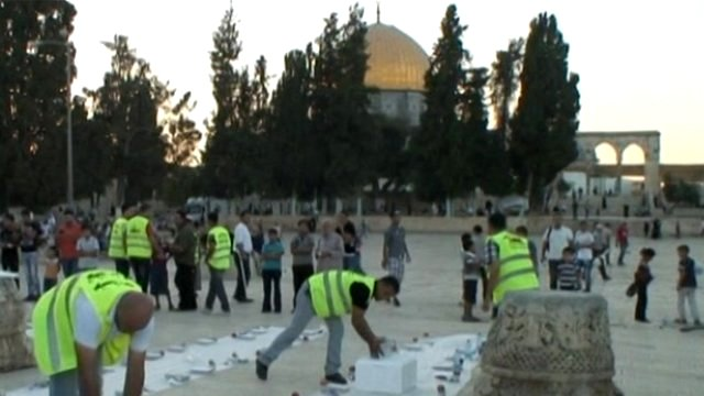 Volunteers lay food outside Al Aqsa mosque