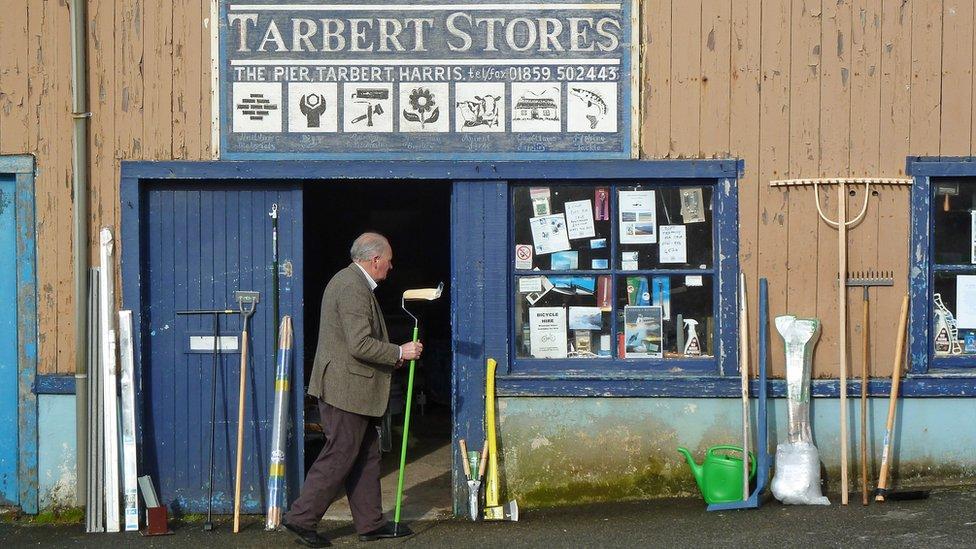Man standing outside a shop on Tarbert