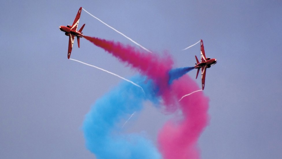 Two of the Red Arrows fly overhead