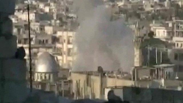 Smoke rises over city