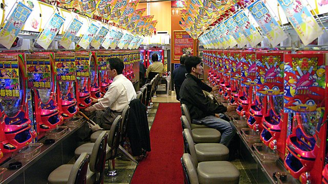 Customers in a pachinko parlour in Tokyo