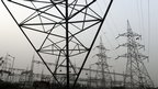 High voltage electricity towers pictured on the outskirts of Delhi