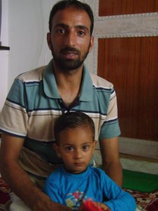 Naseer Ahmad with one of his sons