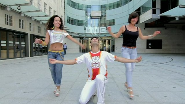 Samba dancers in front of BBC's New Broadcasting House in London