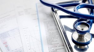 Blood test and other health check results beside a stethoscope