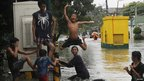 Boy jumping into floodwater on 7 August 2012