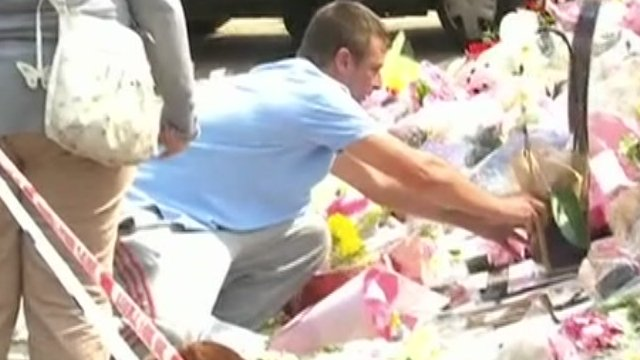People laying flowers for Tia