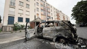 A burnt car in Amiens, northern France, on Tuesday following overnight clashes between youths and police