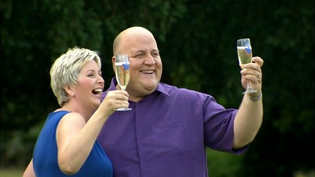 Adrian and Gillian Bayford holding glasses of Champaign