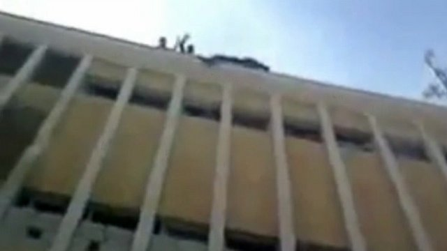 Rebels appear to throw body from building