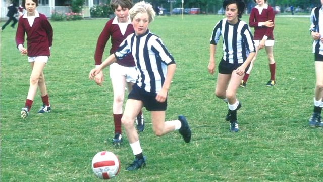 Schoolboys playing football