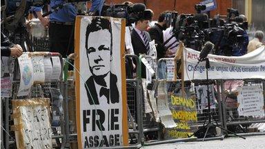 Media gather outside the Ecuadorian Embassy