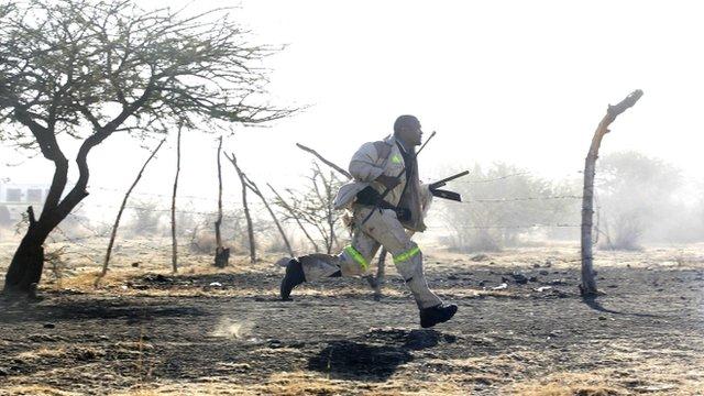 S African miner flees police