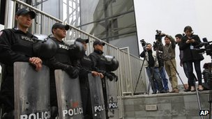 Police and media outside the British Embassy in Quito, Ecuador