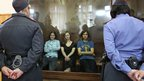 Pussy Riot members Nadezhda Tolokonnikova, Maria Alekhina and Yekaterina Samutsevich (L-R) in court in Moscow (8 Aug 2012)