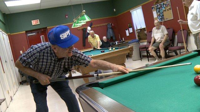 Senior citizens playing pool