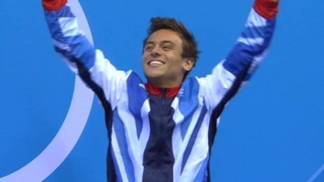Tom Daley celebrating on the podium