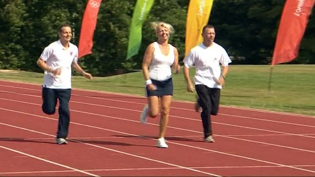 Three people running on athletics track