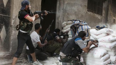 Rebels fighting in the Salaheddin neighbourhood of Syria's northern city of Aleppo, 22 August