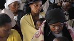 Mourner attends memorial service at Lonmin platinum mine near Rustenburg, South Africa. 23 Aug 2012