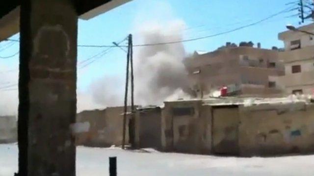 Amateur footage showing bombardment of buildings