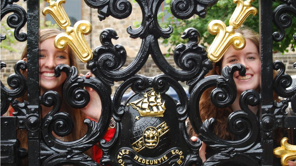 Victoria and Ashley looking through gates