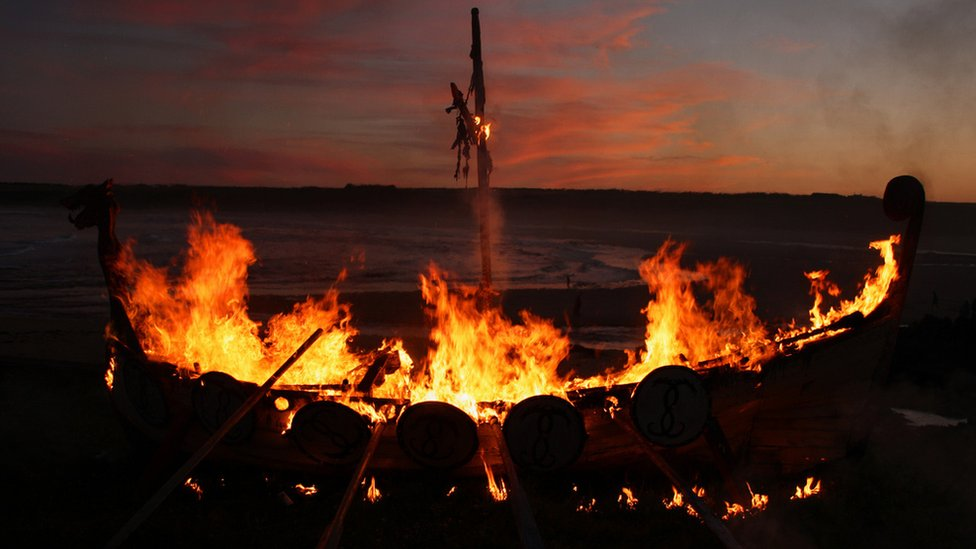 Replica Viking longboat engulfed in flames