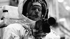 Neil Armstrong shows his spacesuit and camera at the Manned Spacecraft Center in Houston, Texas, 18 April 1969