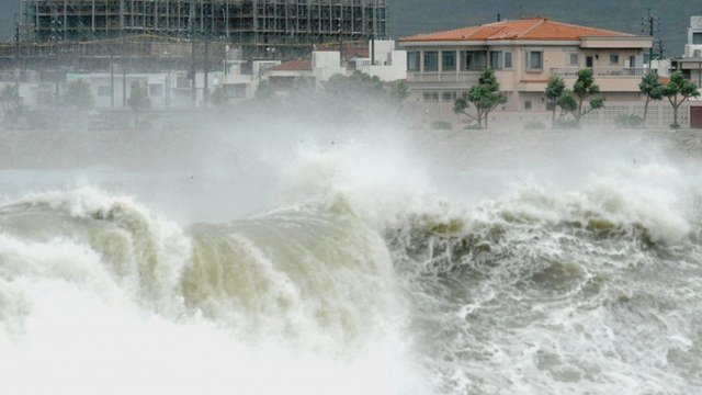 High waves pound the shore in Yonabarucho, Okinawa Prefecture, Japan