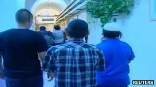 Two of the children are escorted to a courtroom in Jerusalem (26 August 2012)