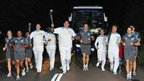 A torchbearing team carries the Paralympic Flame on the Torch Relay leg between Aylesbury and Weston Turville