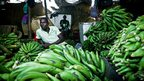 A South Sudanese market trader sits in his shop selling bananas in Juba -  Tuesday 28 August 2012