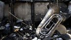 Musical equipment is seen in a charred room of the Salvation Army Church that was attacked by rioting youths in the city of Mombasa in Kenya - Tuesday 28 August 2012