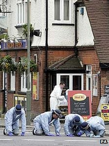 Police forensics team searching outside The Railway Tavern in Edgware